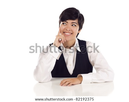 Attractive Smiling Mixed Race Young Adult Female At White Table Looking Up and Away Isolated on a White Background. - stock photo