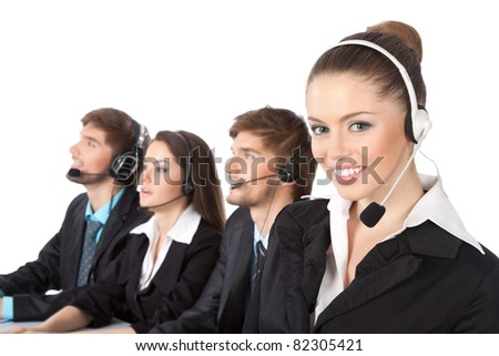 Attractive Smiling positive young businesswoman and colleagues in a call center office, support phone operators with headset at workplace over white background, agent friendly looking at camera - stock photo