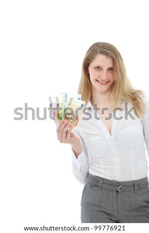 Attractive smiling successful businesswoman holding several denominations of euro banknotes fanned out in her hand