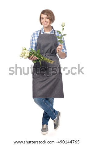 attractive smiling woman florist with beautiful rose flowers isolated on white background. floriculture, floristry and business concept. online flower shopping