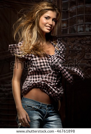 attractive smiling woman in  the interior - stock photo