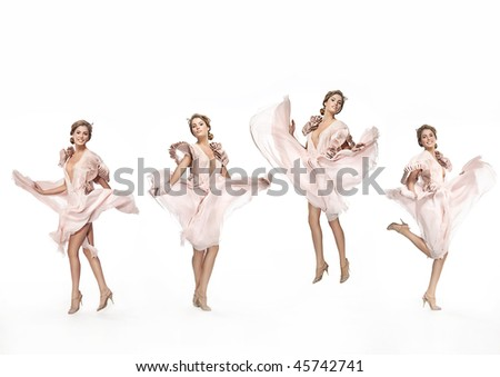 attractive smiling woman jumping in dress on white background - stock photo