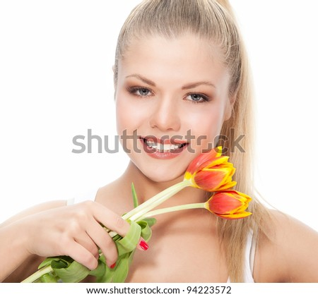 Attractive smiling woman looking to the camera with red yellow flower on white background