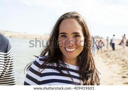 attractive smiling woman portrait on the beach - stock photo