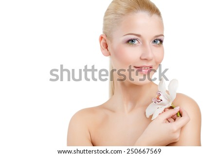 attractive smiling woman portrait on white background. Beautiful woman with orchid flower, isolated on the white. Beauty face of beautiful woman with a white orchid flower. Skin care treatment. - stock photo