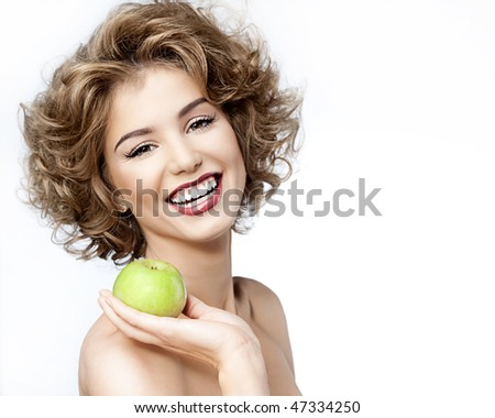 attractive smiling woman portrait on white background with apple - stock photo
