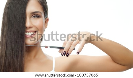attractive smiling woman portrait on white background with scissors - stock photo