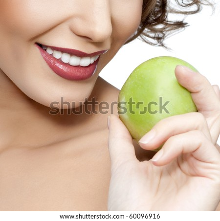 attractive smiling woman portrait with appleon white background - stock photo