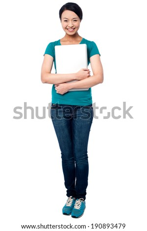 Attractive smiling woman posing with laptop