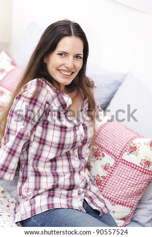 Attractive smiling woman relaxing - stock photo