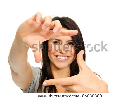 Attractive smiling woman using her hands to create a border around her face - stock photo