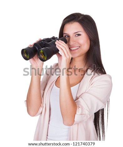 Attractive smiling woman with binoculars isolated on white