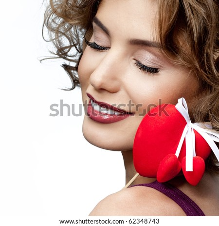 attractive smiling woman with heart on white background - stock photo