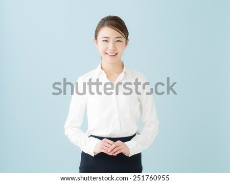 Attractive smiling young business woman - stock photo