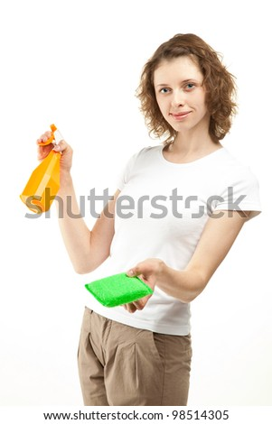 Attractive smiling young woman/housewife holding cleaning supplies; housekeeping concept on white background - stock photo