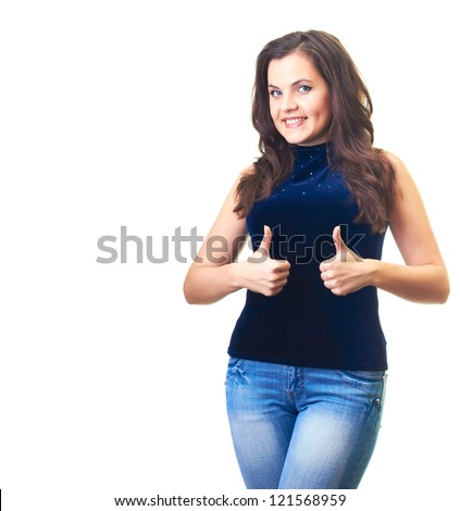 Attractive smiling young woman in a blue shirt and blue jeans shows her finger up with both hands. Isolated on white background - stock photo