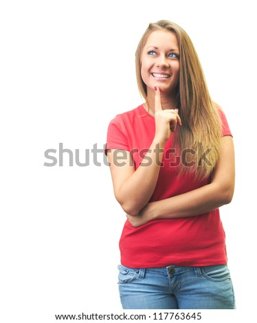 Attractive smiling young woman in a red shirt holding a finger on her chin and looks into the upper-right corner. Isolated on white background