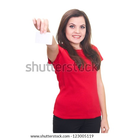 Attractive smiling young woman in a red shirt holding in her right hand poster. Isolated on white background