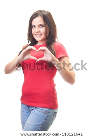 Attractive smiling young woman in a red shirt shows her hands a sign of heart. Isolated on white background