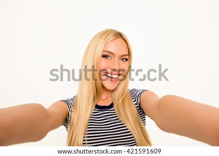 Attractive smiling young woman making pretty selfie - stock photo