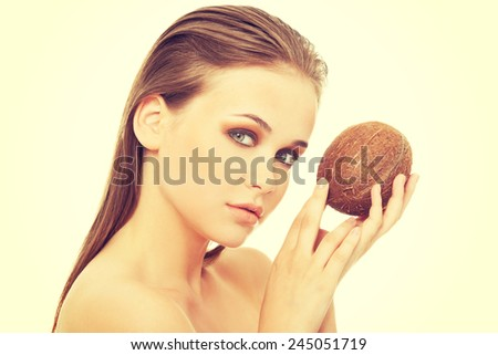 Attractive spa woman with coconut.  - stock photo