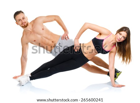 Attractive sport couple - man and woman doing fitness exercises on the white background - stock photo