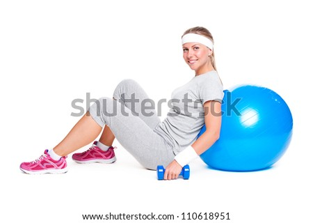 attractive sportswoman sitting with ball and dumbbells. isolated on white background - stock photo