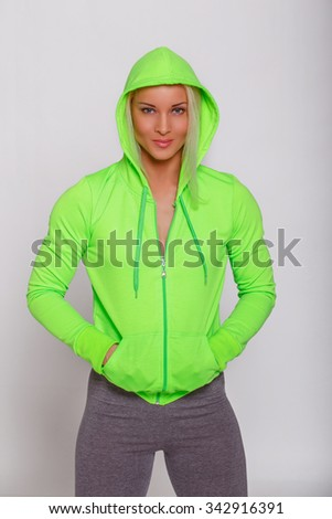 Attractive sporty female in green hoodie. - stock photo