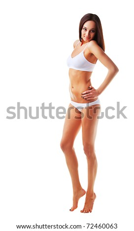 Attractive sporty slim woman on white background - stock photo