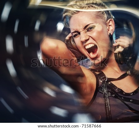 Attractive steam punk girl with headphones - stock photo