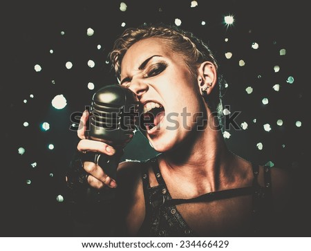 Attractive steampunk girl singer with microphone
