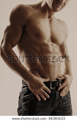 Attractive strong man - stock photo