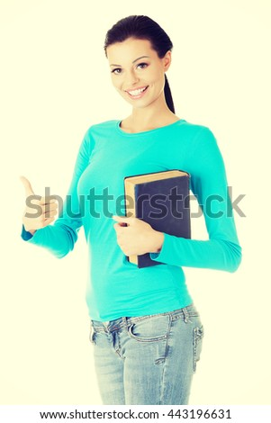 Attractive student woman gesturing OK, - stock photo