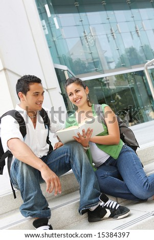 Attractive students relaxing on college university campus - stock photo
