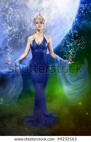 attractive stunning woman with a long elegant leather dress and a  stole with creative make up and hair style on space background - stock photo