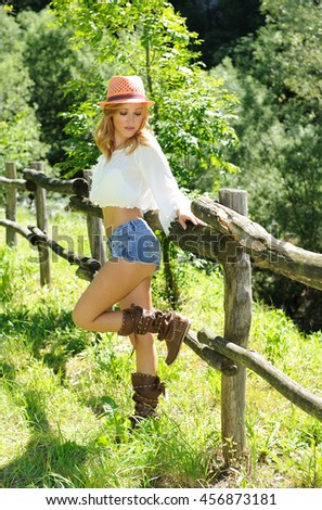 Attractive stylish blonde girl, countryside - stock photo