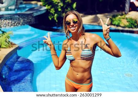Attractive tan woman having fun outdoor - stock photo