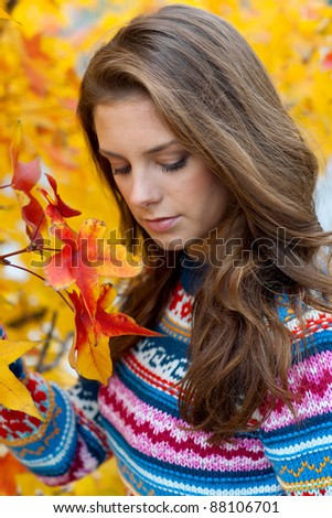 attractive teen girl in autumn scene making sad expression