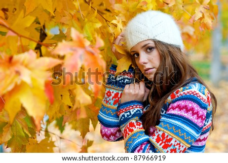 attractive teen girl in colorful sweater outside