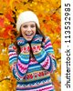 attractive teen girl in front of the colorful autumn leaves - stock photo