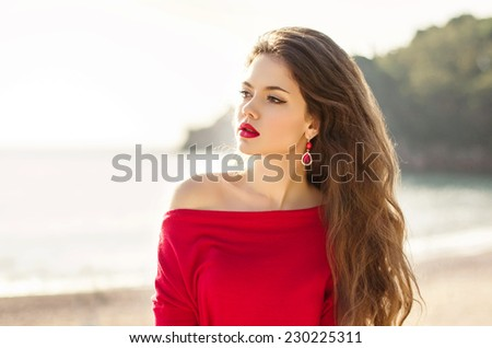 Attractive teen girl outdoor portrait, fashionable woman with red lips and long wavy hair. - stock photo