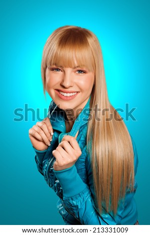 attractive teen girl with blond hair smiling - stock photo