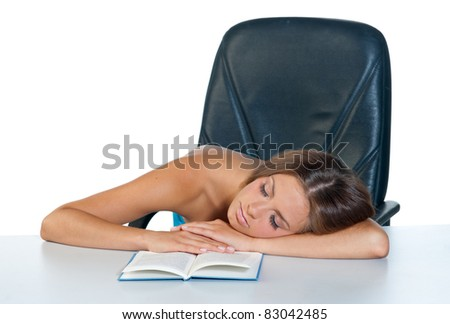 attractive teen sleeping at the table with open book - stock photo