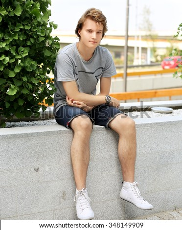 Attractive teenage boy in urban background - stock photo