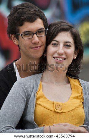 Attractive teenage couple embracing