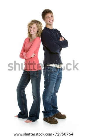 Attractive teenage couple standing back to back with arms crossed isolated on white background - stock photo