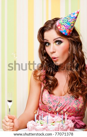 attractive teenage girl celebrating her birthday with cake - stock photo