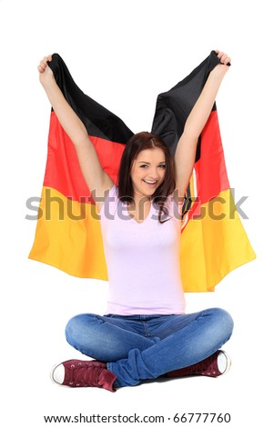 Attractive teenage girl cheering with german flag. All on white background. - stock photo