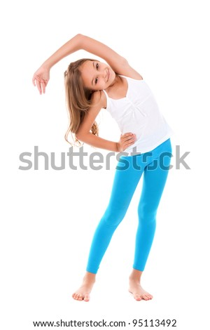 Attractive teenage girl exercising isolated on white background