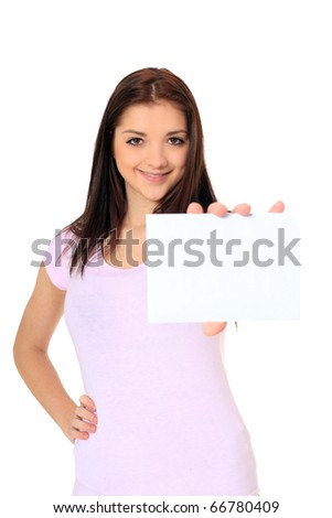 Attractive teenage girl holding blank white card with plenty of text space. All on white background. - stock photo